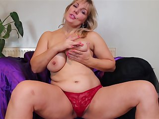 Buxom broad in the beam busty mature bungler MILF Danielle strips at home