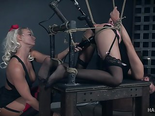 Eden Sin strapped to a table and tortured by machines and London Well up