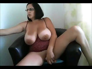 Extraordinarily giant breasted whore rides a dildo on webcam like a mad one