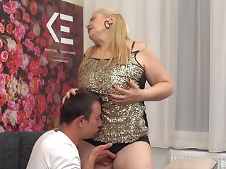 Mature clumsy granny gets fucked by a younger stud with a large cock