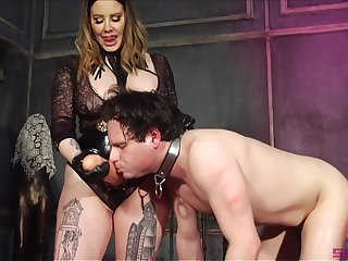 Thick Domme introduces her underling to her huge phallus