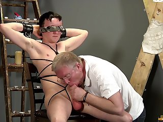 Old guy sucks twink's dick during their BDSM uncaring play