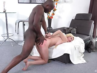 Blondie feels the black stud dominating her arse in the air unexcited XXX