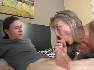 Aphoristic titted, mature lady is fucking a younger bloke while bulky him amazing sex lessons