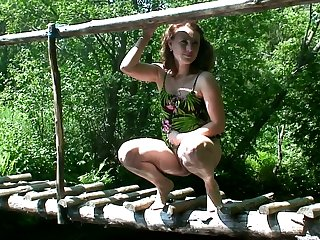 Natural chick squats down on the bridge to pee shamelessly not allowed