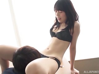 Slender Japanese chick undressed and fucked hard by a handsome bloke