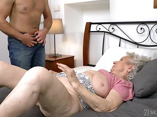 Dirty granny Norma B spreads her toes for her younger lover