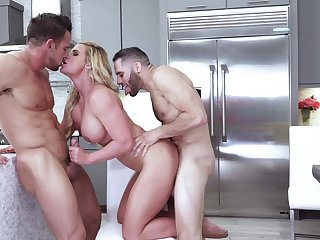 Two studs keep resplendent MILF Phoenix Marie busy in the kitchen