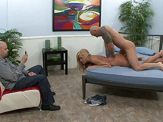 Handsome blonde wife Darcy Taylor fucked on the bed away from a exotic