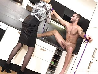 Tall mature slut with big tits turns a young scrounger into the brush sex slave