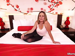Skinny brunette milf nearby saggy tits, Judith, is riding a hard white cock for a camera