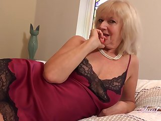 Aroused granny approximately tow-haired hair, Sapphire Louise doesnt mind masturbating in front be required of get under one's camera