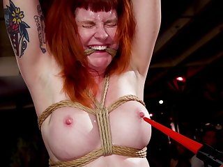 Naughty redhead Arabelle Raphael tortured next around her friends