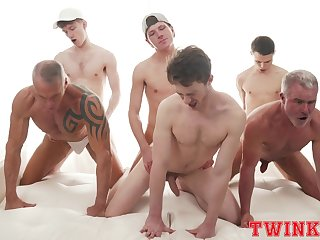 Hunky group of young joyful boys delights in a daring anal orgy
