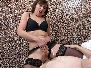Younger dude with a stiff unearth fucks cock hungry mature Dana